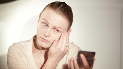 Young Woman Is Putting Cosmetic Cream On Her Face stock footage