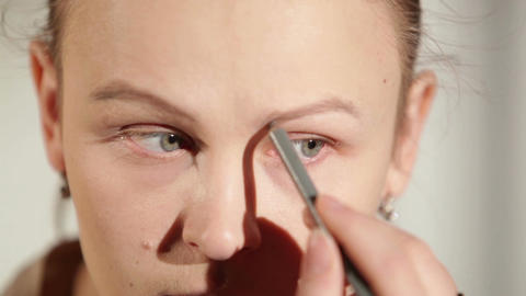Young woman shaping her eyebrows Stock Video Footage