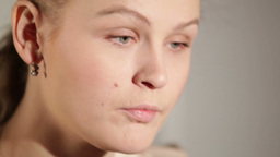 Portrait of a young adult woman applying blusher Stock Video Footage