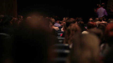 People in the theatre. Pan shot from the back Stock Video Footage