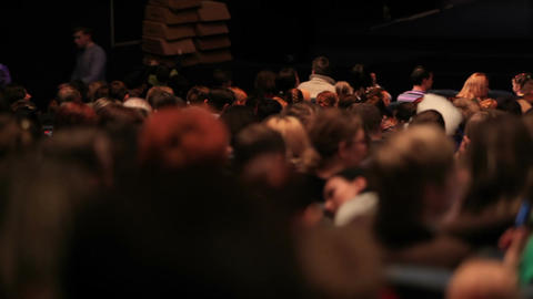 People in the theatre. Pan shot from the back Footage
