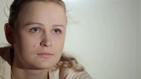Young woman is watching an interesting film on tv. Close... Stock Video Footage