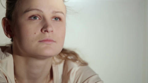 Young woman is watching an interesting film on tv. Close up shot with beautiful light Footage