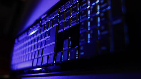 Man hands typing on the blue keyboard. Time lapse Stock Video Footage
