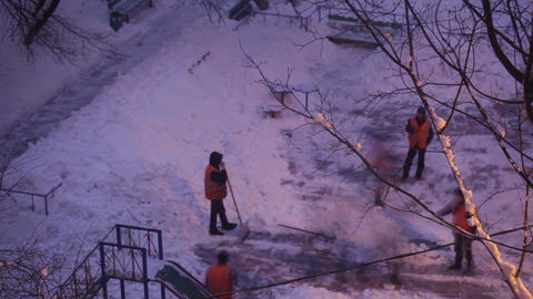 Street cleaners in orange uniform removing the snow. Time... Stock Video Footage