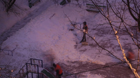 Street cleaners in orange uniform removing the snow. Time lapse Footage