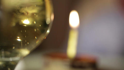 Glass of champagne and candle in the tiramisu cake.... Stock Video Footage