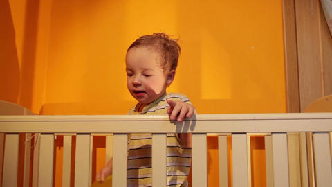 Boy plays with balloon in the playpen Stock Video Footage