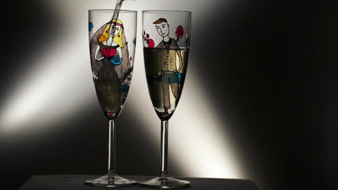 Vintage wedding champagne glasses on black background Stock Video Footage