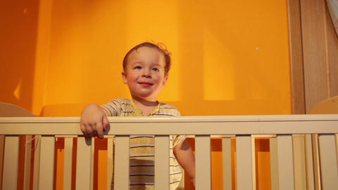 Boy smiling in playpen Footage