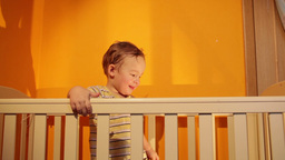 Boy smiling in playpen Stock Video Footage