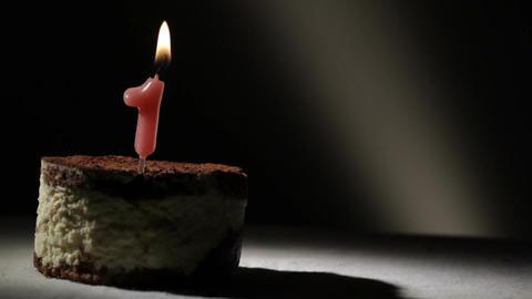 Candle one in tiramisu cake Stock Video Footage