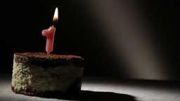 Candle one in tiramisu cake Footage