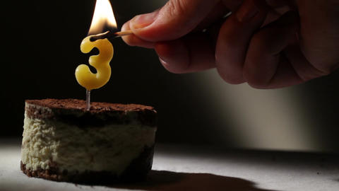 Candle three in tiramisu cake Stock Video Footage