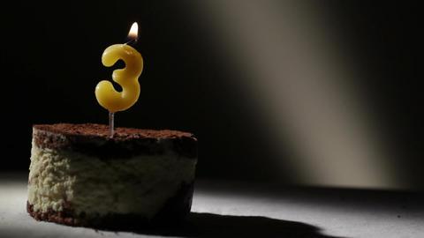 Candle three in tiramisu cake Footage