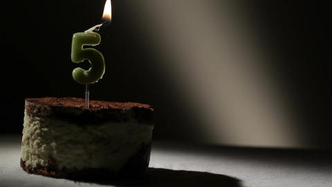 Candle five in tiramisu cake Stock Video Footage