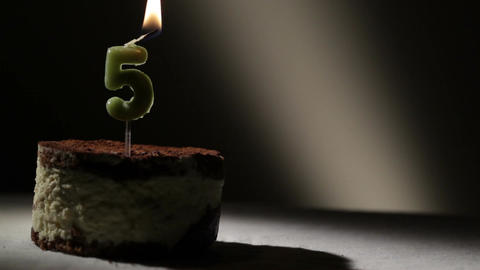 Candle five in tiramisu cake Footage