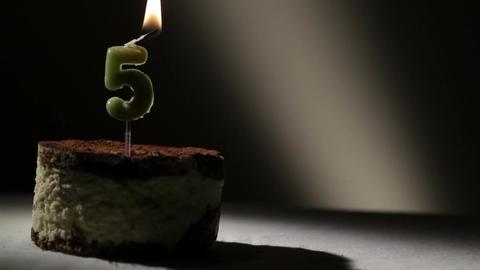 Candle five in tiramisu cake Stock Video Footage