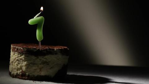 Candle seven in tiramisu cake Stock Video Footage