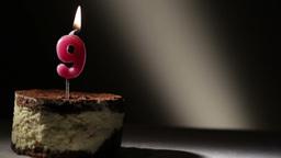 Candle nine in tiramisu cake Stock Video Footage
