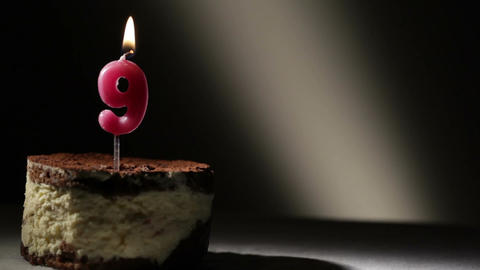Candle nine in tiramisu cake Footage