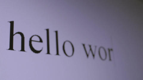 Typing Hello world. Perspective macro shot Footage