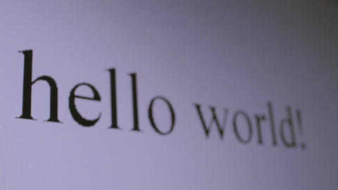 Typing Hello world. Perspective macro shot Stock Video Footage