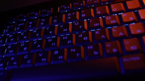 Man hands in orange and blue colors typing on the blue... Stock Video Footage