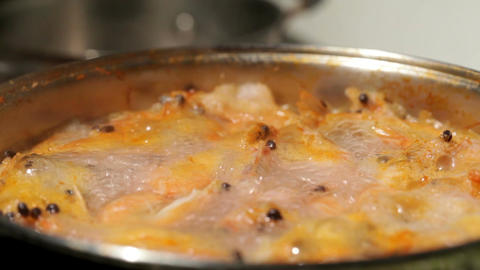 Shrimp are simmered in a saucepan Stock Video Footage
