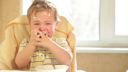 Little boy is crying because he doesn't want to eat more... Stock Video Footage