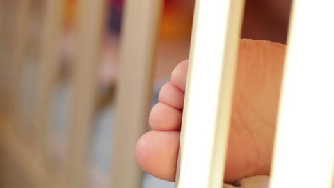 Baby's foot. Closeup. Sunlight Stock Video Footage