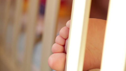 Baby's foot. Closeup. Sunlight Footage