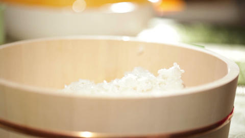 Cooking sushi. Mixing rice in wooden plate Stock Video Footage