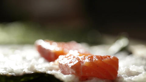 Making sushi rolls with salmon and philadelphia cheese Stock Video Footage