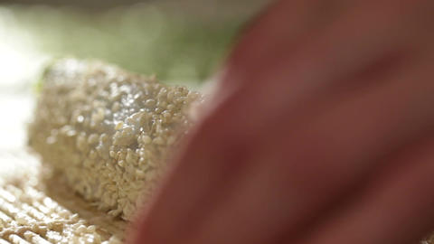 Putting sesame on sushi roll Stock Video Footage