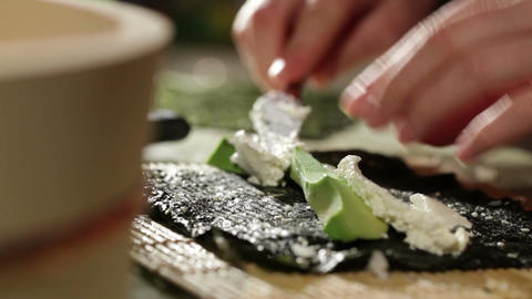 Cooking sushi roll with avocado and philadelphia cheese Footage
