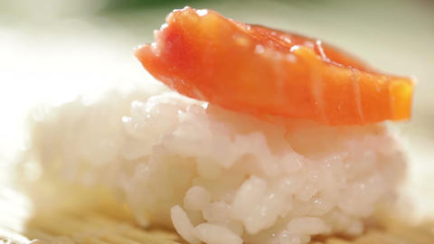 Putting piece of salmon on the rice. Cooking sushi roll Footage