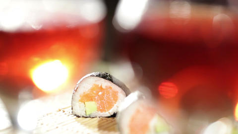 Sushi rolls and plum wine. Focus pulling Stock Video Footage