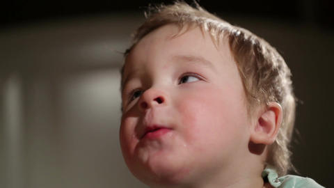 Two year old boy blowing soap bubbles Stock Video Footage