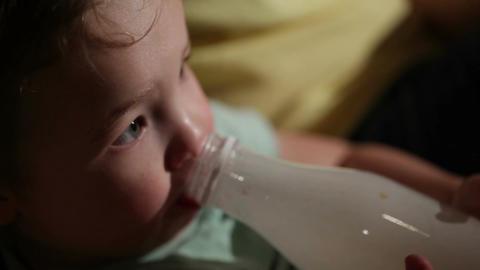 Boy drinks yogurt from a bottle Stock Video Footage