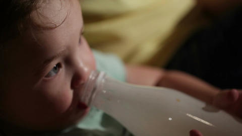 Boy drinks yogurt from a bottle Stock Video Footage