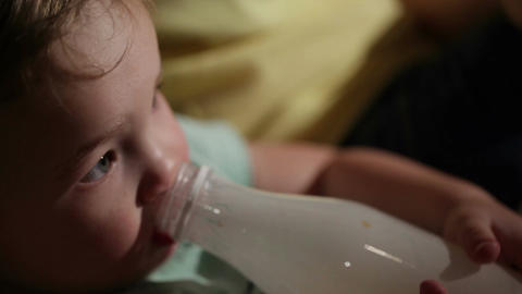 Boy Drinks Yogurt From A Bottle stock footage