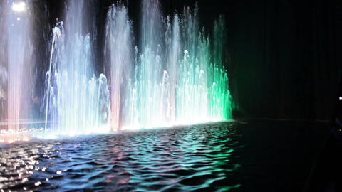 Colorful fountain and water surface Footage