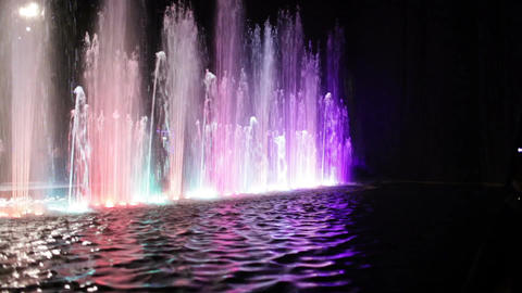 Colorful fountain and water surface Stock Video Footage