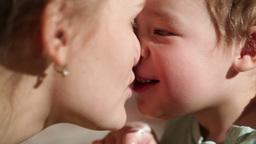Mom and her son kissing. Lovely close ups Stock Video Footage