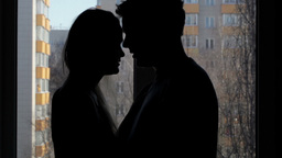 Two lovers embracing and kissing. Silhouette Footage