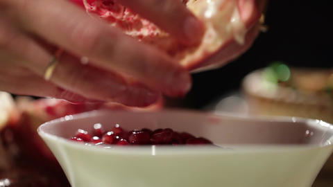 Woman's hands removes seeds from the pomegranate Footage