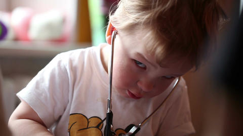 Boy plays a doctor Stock Video Footage