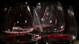 Red wine is poured in the glasses. Macro shot Footage