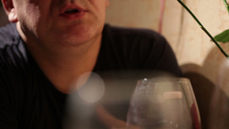 Middle-aged man is talking during lunch. Close up Stock Video Footage